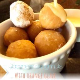 Orange glazed Japanese doughnut holes.